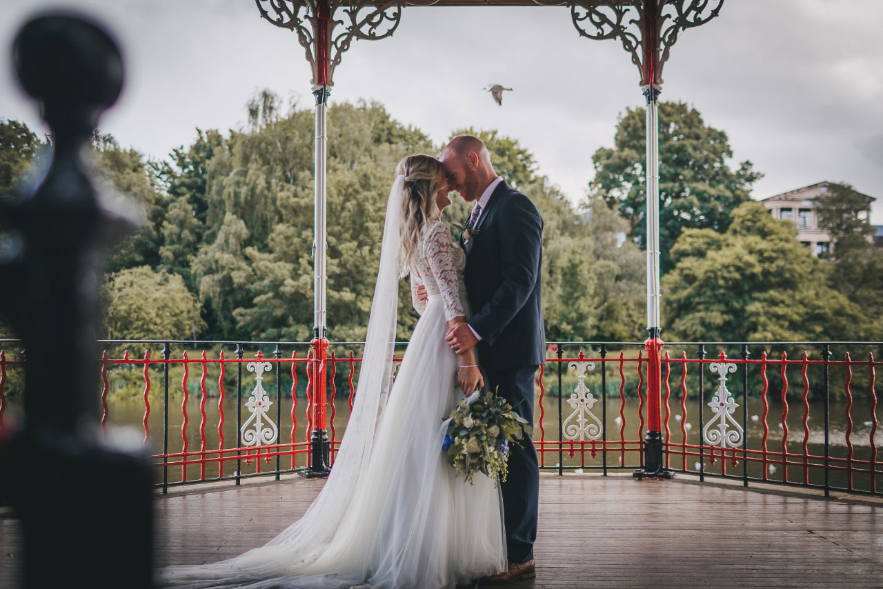 Newlyweds embrace in the bandstand
