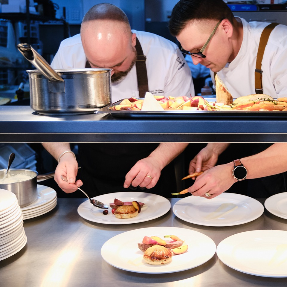 Chefs preparing food in the kitchen at Old Palace Chester